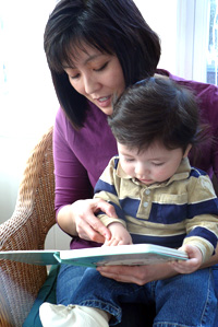 Mother and baby looking at a children's book together